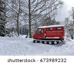 Small photo of ŠPINDLER?V MLÝN, CZECH REPUBLIC - JANUARY, 16, 2017: Photo of a red snowmobile, with an advert on a pension Labská Vyhlídka in Czech Republic.