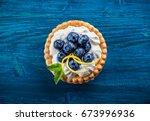 delicious blueberry tartlets... | Shutterstock . vector #673996936