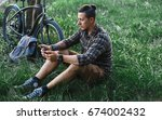 Young Male Cyclist Sits On...