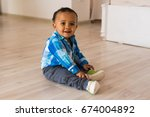 small child tries to put on his ... | Shutterstock . vector #674004892