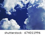 blue sky with cumulus oblongs... | Shutterstock . vector #674011996