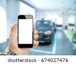 hands holding white screen... | Shutterstock . vector #674027476