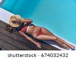 getting golden tan. full length ... | Shutterstock . vector #674032432