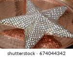 christmas star background on a... | Shutterstock . vector #674044342
