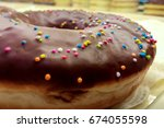 colorful chocolate sprinkles on ... | Shutterstock . vector #674055598