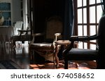 vintage chair near window with... | Shutterstock . vector #674058652