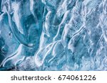 ice textured wall background in ... | Shutterstock . vector #674061226