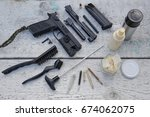 pistol stripping and cleaning...   Shutterstock . vector #674062075