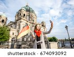 young woman tourist making... | Shutterstock . vector #674093092