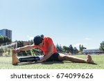 disabled man athlete stretching ... | Shutterstock . vector #674099626