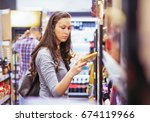 young woman shopping in grocery ... | Shutterstock . vector #674119966
