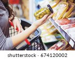 close up of woman holding jar... | Shutterstock . vector #674120002
