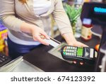 paying with a credit card in a... | Shutterstock . vector #674123392
