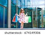 cute little girl on shopping.... | Shutterstock . vector #674149306