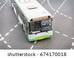 bus at city intersection top... | Shutterstock . vector #674170018