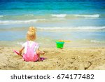 baby girl playing in the sand... | Shutterstock . vector #674177482