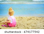 baby girl playing in the sand... | Shutterstock . vector #674177542