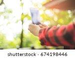 closeup of woman hands using...   Shutterstock . vector #674198446