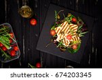 fresh salad with grilled cheese ... | Shutterstock . vector #674203345