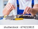computer repairman repairing... | Shutterstock . vector #674213815