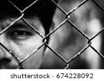 depressed man standing behind a ... | Shutterstock . vector #674228092