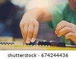close up hand asian boy... | Shutterstock . vector #674244436