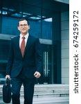 young businessman walking... | Shutterstock . vector #674259172
