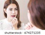 portrait in mirror of smiling... | Shutterstock . vector #674271235