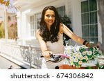 eastern girl sitting on bicycle ...   Shutterstock . vector #674306842