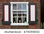 beautiful window in a brick... | Shutterstock . vector #674354032