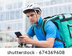 courier on bicycle delivering... | Shutterstock . vector #674369608