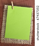 green paper note on the textile background - stock photo