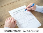 hand filling the unemployment... | Shutterstock . vector #674378212