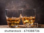 whiskey with ice in glasses on... | Shutterstock . vector #674388736