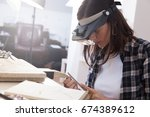 jeweler at work  crafting in a... | Shutterstock . vector #674389612