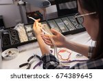 jeweler at work  crafting in a... | Shutterstock . vector #674389645