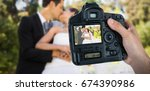 cropped hand of photographer... | Shutterstock . vector #674390986