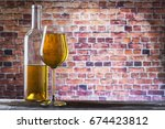 white wine on old wooden table  ...   Shutterstock . vector #674423812