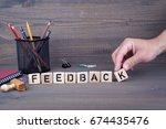 feedback. wooden letters on... | Shutterstock . vector #674435476
