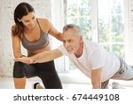 smiling instructor supporting... | Shutterstock . vector #674449108
