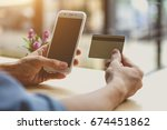 man using mobile smartphone and ... | Shutterstock . vector #674451862