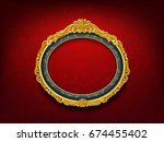 oval vintage frame on red wall | Shutterstock .eps vector #674455402