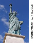 Statue Of Liberty Against Blue...