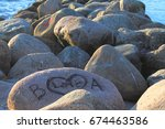 large stones by the beach at... | Shutterstock . vector #674463586