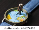 old man on watches with world... | Shutterstock . vector #674527498