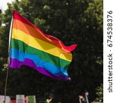 gay rainbow flag being waved at ...   Shutterstock . vector #674538376