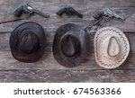 three cowboy hats and three...   Shutterstock . vector #674563366