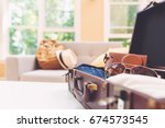 packing a suitcase and backpack ...   Shutterstock . vector #674573545
