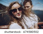 happy woman with windy hair in... | Shutterstock . vector #674580502