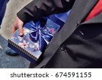 male hand dressed in a suit... | Shutterstock . vector #674591155